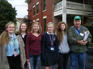 Ross Bassett, Vice-President of the West Park Historical Society with St. Joseph Academy students at the Sherman House on the corner of Triskett and Lorain Rd.      Historical Walking Tour - September 2014